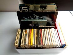 A box of a large quantity of CD's and books relating to The Beatles
