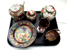 A tray containing 20th century oriental wares to include famille rose teapot with wicker handle,