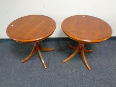 A pair of Bradley Furniture reproduction yew wood pedestal wine tables