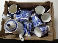A plastic crate containing assorted Ringtons china
