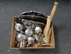A box containing a quantity of stainless steel tea ware, napkin rings,