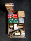 Two boxes of boxed LED lanterns, carpet sweeper, Tens unit, storage boxes, place mats,