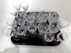 A tray containing assorted lead crystal drinking glasses to include Edinburgh Crystal