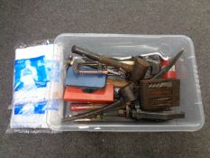 A box containing assorted hand tools, G clamps, pick axe head,
