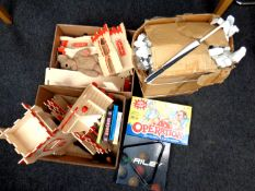 Two boxes containing children's toys to include wooden fort, board games, Riley pool balls,