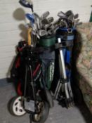 Three golf bags of assorted irons and drivers to include Dunlop, Ben Sayers, Big Bursar,