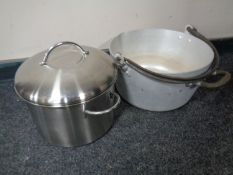 A stainless steel lidded pan together with an aluminium cast iron handled jam pan