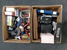 Two boxes containing paint brushes, cased socket sets, drill bits, sander, glue gun,
