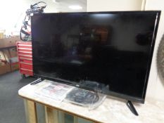 """A JVC 32"""" LED TV with remote and instructions"""