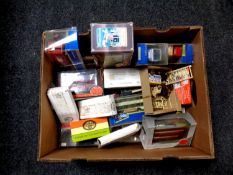 A box containing a quantity of boxed die cast vehicles to include Corgi trams and Parcel Force