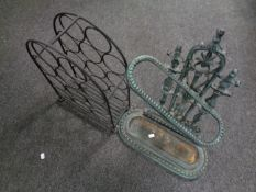 A cast iron Victorian style stick stand together with a metal wine rack