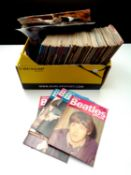 A box of a large quantity of 1980's Beatles Monthly books together with a quantity of unframed