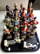 A tray containing seventeen china figures of soldiers in military dress
