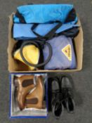 A box of sleeping bag, mats, folding tripod seat, cool bag,
