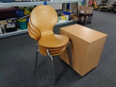 A set of four contemporary beech stacking chairs on metal legs together with a three drawer office