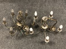 A pair of antique brass finish six-branch light fittings (2)