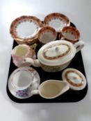 A tray containing part Victorian tea service,