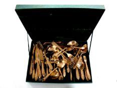 A canteen of brass cutlery