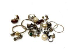 Twelve pairs of silver earrings