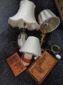 A box containing brass table lamp with shade together with two others,