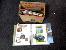 A box containing two folders containing late 20th century die cast car catalogues to include Corgi,