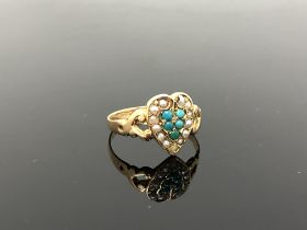 An antique 15ct gold turquoise and seed pearl heart shaped ring