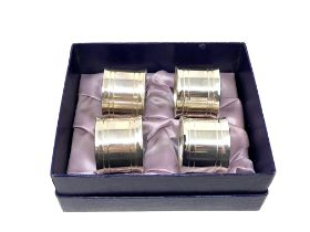 Four heavy silver plated napkin rings