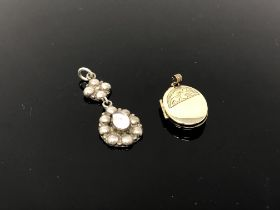 A vintage pendant and a locket