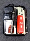 A tray containing cameras, music stand, Hohner melodica,