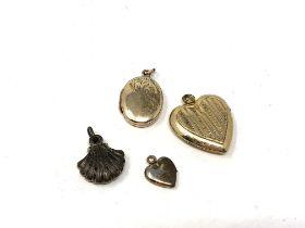 Four vintage lockets