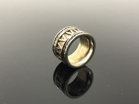 A Greek style band ring