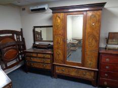 A late 19th century three piece bedroom suite comprising of mirror door wardrobe,