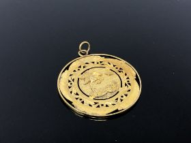 An old gold plated double sided pendant