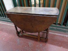 A 19th century oak gate leg table