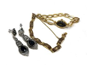A pair of white metal earrings together with a gilt metal bracelet and a lady's watch