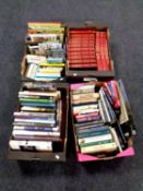 Four boxes containing hardback books, reference, autobiography, Viz annuals and comics,