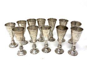 Twelve silver miniature Kiddush cups
