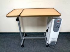 A bed table together with a Delonghi oil filled radiator