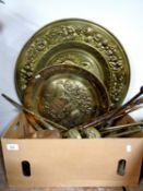 A box of a quantity of antique and later brass companion pieces, pair of brass fire dogs,