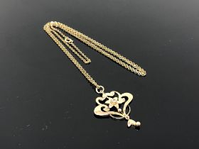 An antique 9ct gold pendant suspended on chain