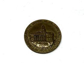 A commemorative medallion,
