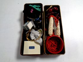 An oriental style lacquered trinket box containing assorted costume jewellery to include Bakelite