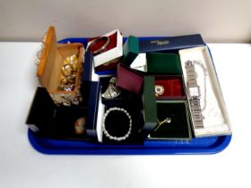 A tray containing a quantity of costume jewellery to include cameo brooch, bracelets,