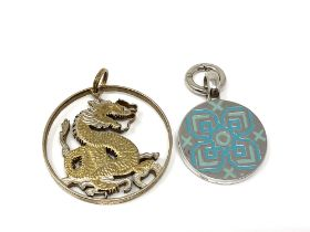 A sterling silver and enamel pendant together with a fine silver gilt pendant.