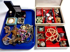 A tray containing a jewellery box containing a large quantity of assorted costume jewellery,