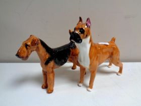 Two Royal Doulton figures of dogs,