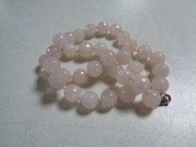 A rose quartz beaded necklace