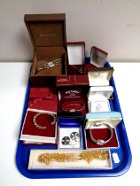 A tray containing assorted costume jewellery, silver pendant on chain, Celtic earrings,
