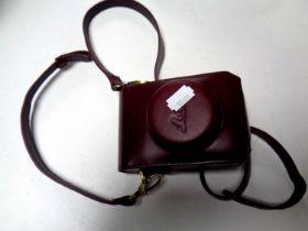 A contemporary Leica camera case on strap