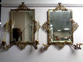 A pair of antique ornate brass framed bevel edged mirrors with candle sconces (as found)